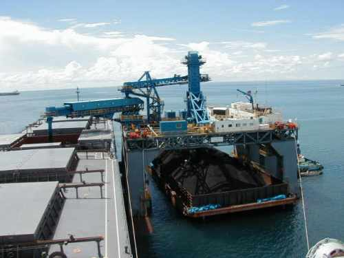 SST transshipping coal from barge to ocean going vessel
