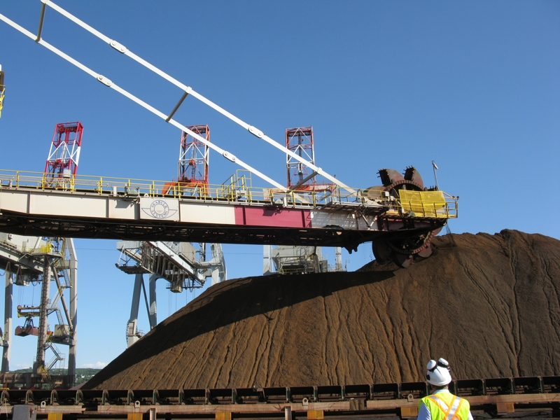 Stacker reclaimer digging iron ore